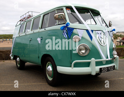 VW campervan being used as a wedding car, Cornwall, UK - Stock Photo
