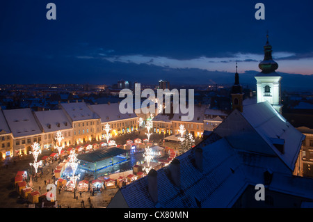 Christmas market, tree and lights in old town square in Sibiu Transylvania Romania - Stock Photo
