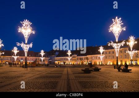Christmas light in old town square in Sibiu Transylvania Romania - Stock Photo