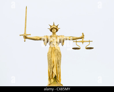 The gold bronze Lady Justice statue with sword and scales above the Central Criminal Court, Old Bailey, London - Stock Photo