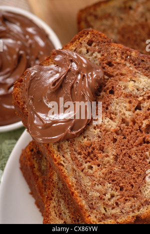 Freshly baked banana and chocolate nut bread with Nutella - Stock Photo