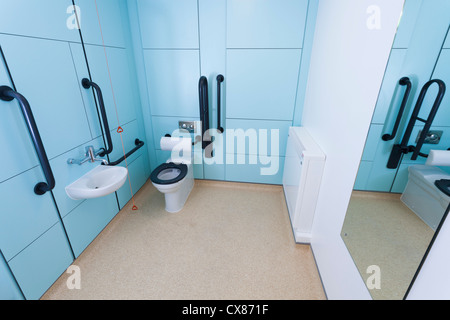 Disabled toilet room with grab rails. - Stock Photo