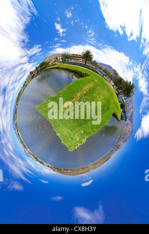 Little planet panorama of a lake with mountains - Stock Photo