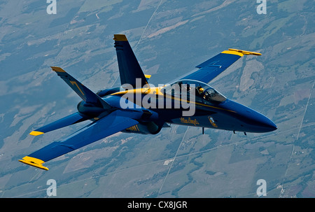 A Navy Blue Angel FA-18 Hornets from Naval Air Station Pensacola, Fla., flies into formation after being refueled - Stock Photo