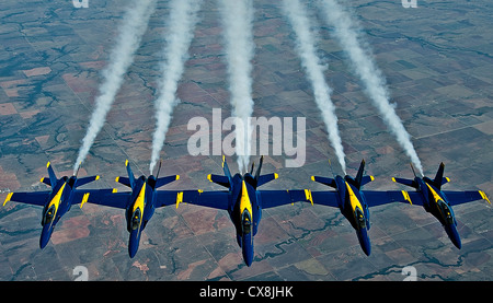A formation of Navy Blue Angel FA-18 Hornets from Naval Air Station Pensacola, Fla., fly together after being refueled - Stock Photo
