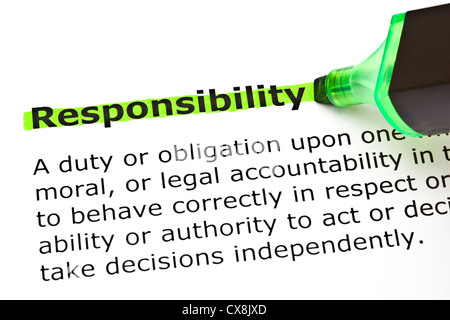 Definition of the word Responsibility highlighted in green with felt tip pen - Stock Photo