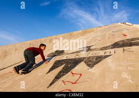 Child climbing up the Pyramid, the former International Center of Culture. Tirana, Albania - Stock Photo