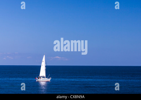 Small sailing yacht in the big blue sea. - Stock Photo