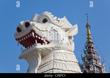Giant CHINLES (half lion half dragon) guard the southwest entrance to MANDALAY HILL - MANDALAY, MYANMAR - Stock Photo