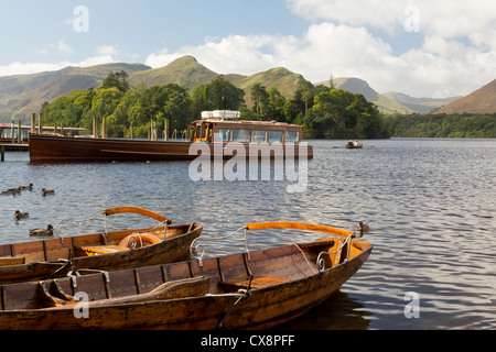 Piers / Landing stages, rowing boats and Launch on the edge of Derwent Water in English Lake District, UK in early - Stock Photo