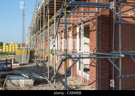 Construction site with family houses in scaffolding - Stock Photo