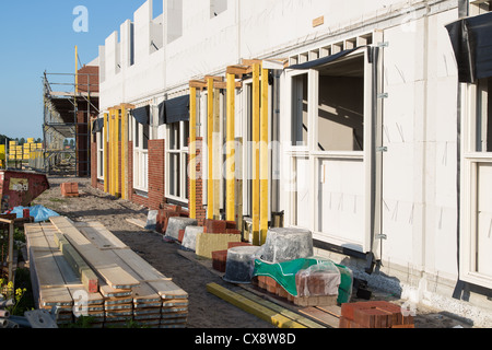 Building family houses with sand-lime bricks at a construction site - Stock Photo