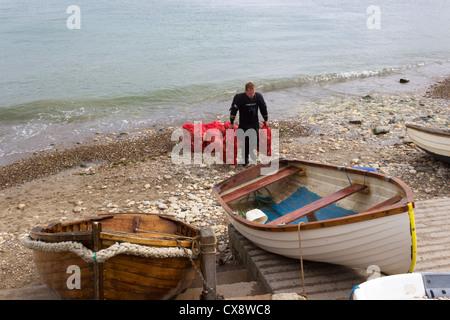 Fisherman carries bagfuls of Scallops - Stock Photo