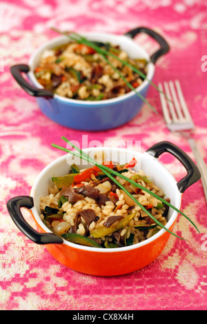 Rice with curry and Chinese mushrooms. Recipe available. - Stock Photo