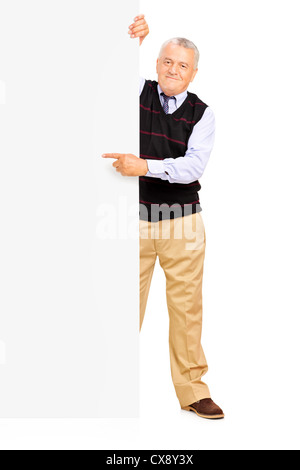 Full length portrait of a gentleman pointing on a blank banner - Stock Photo