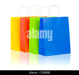 colorful shopping bags set including red, yellow, blue and green on white background - Stock Photo