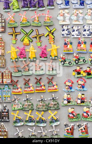 Fridge magnet souvenirs on sale at a tourist souvenir shop in Amsterdam - Stock Photo