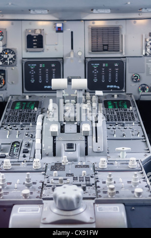 Central control panel and throttles of a KLM Fokker 100 - Stock Photo