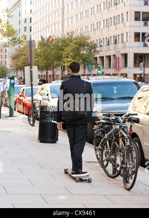 A young professional riding a skateboard in the city -  Washington DC USA - Stock Photo
