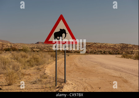 Typical road sign warning of elephants on the road ahead in Namibia, Africa - Stock Photo