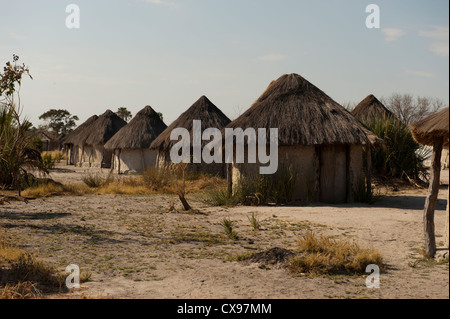 African village with thatched rondavel huts in the Okovonga Delta region of Botswana - Stock Photo