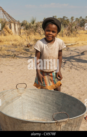 Portrait of a young African girl at play in a village in the Okovonga Delta of Botswana - Stock Photo