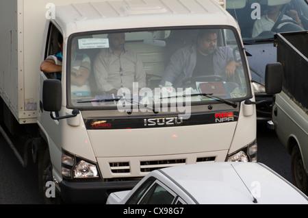 A truck driver and two passengers stuck in traffic jam in Tajrish, Tehran, Iran - Stock Photo