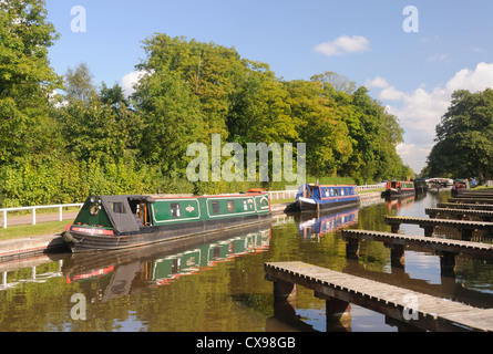 Narrowboats moored on the Trent & Mersey Canal at Fradley Junction, Staffordshire, England - Stock Photo
