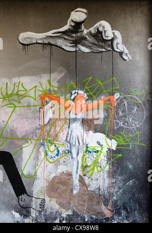 Puppet StreetArt Graffiti on walls Liverpool City centre graphic artist political statement - Stock Photo