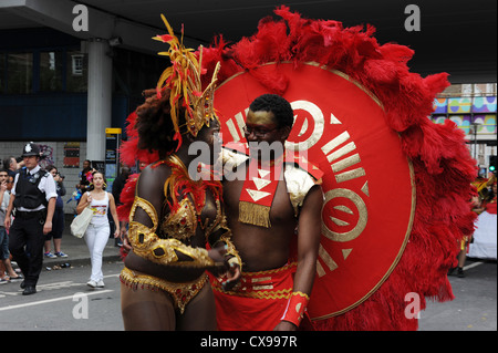 Performers dancing in the parade at Notting Hill Carnival on Monday 27th August 2012. - Stock Photo