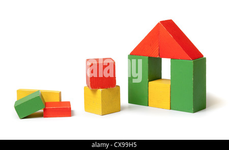 Simple house made from colorful wooden building blocks - Stock Photo