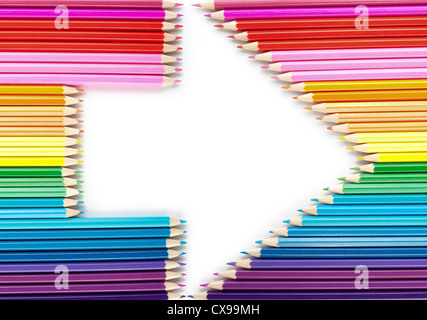Arrow made from color pencils isolated on white - Stock Photo