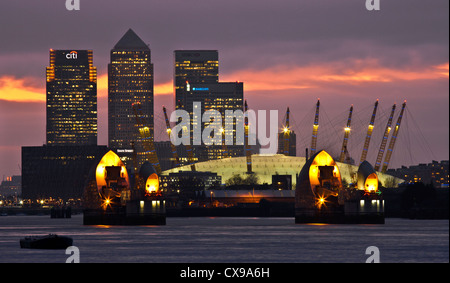 O2 arena and Canary Wharf towers viewed from the Thames barrier in London, UK. - Stock Photo