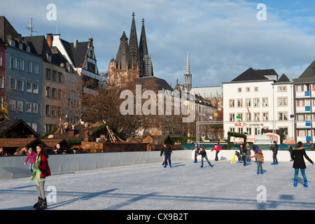 Cologne Cathedral and skating rink during the Christmas market, Altmarkt, North Rhine Westphalia, Germany - Stock Photo