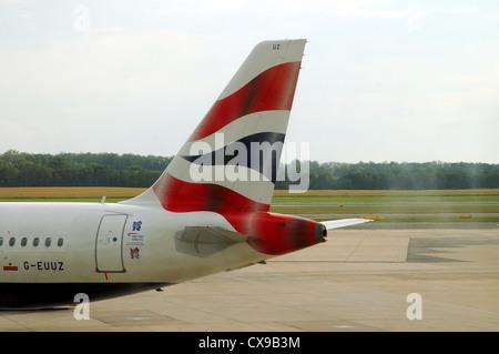 British Airways logo on tail plane of passenger aircraft Airbus A 320 - Stock Photo