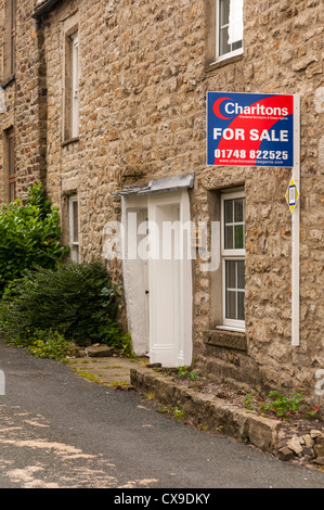 A cottage for sale in the village of Reeth in Swaledale in North Yorkshire, England, Britain, Uk - Stock Photo
