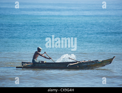 Man fishing in a boat, Dili, East Timor - Stock Photo