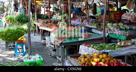 Local produce market selling colourful fruit and vegetables in Dili, East Timor - Stock Photo