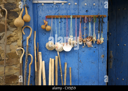 Scallop shells, walking sticks and camino souvenirs on sale along the camino in Spain. - Stock Photo