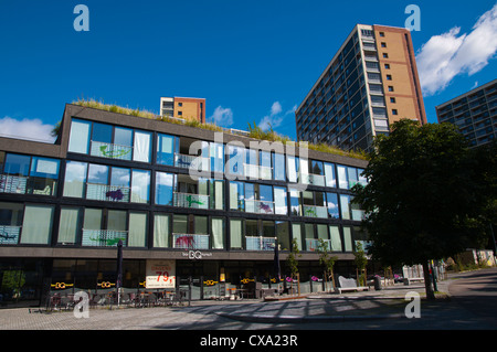 New residential housing with cafes downstairs Gronlandsleiret street Gronland district central Oslo Norway Europe - Stock Photo
