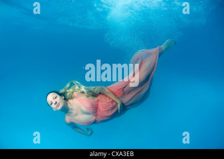 Happy Baby Girl In Snorkeling Mask Swim And Dive Underwater With Fun Stock Photo Royalty Free