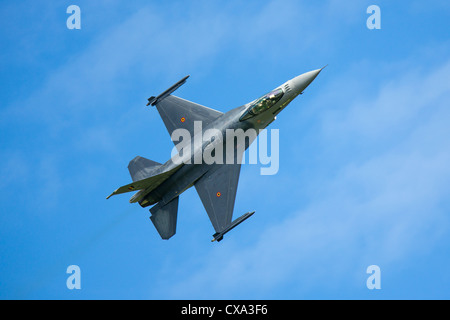 An F-16 figher jet performs at an airshow - Stock Photo