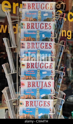 A shop display of Bruges travel guides in different languages outside a store in Bruges, Belgium. - Stock Photo