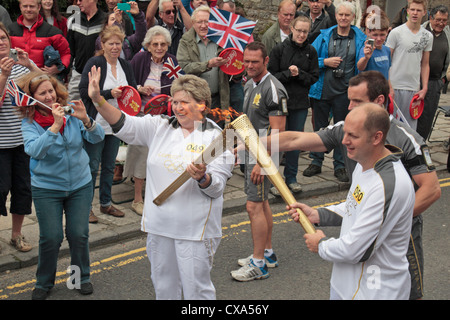 Handover point of the 2012 Olympic Games torch relay in Corfe Castle, Dorset, UK. (13th July 2012) - Stock Photo