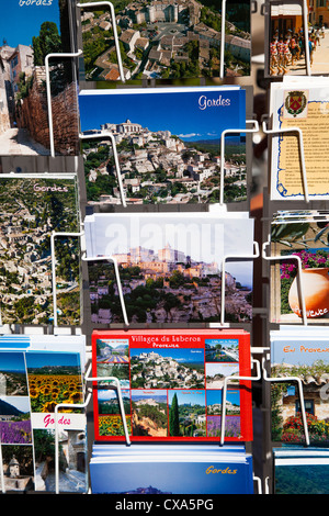 Postcards for sale in the hilltop village of Gordes, Provence, France - Stock Photo
