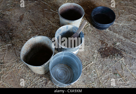 Buckets in a barn, Historical Acadian Village, a re-creation of a 1900s Acadian village in West Pubnico, Nova Scotia, - Stock Photo