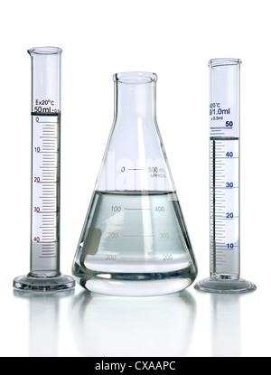 Laboratory glassware with liquids isolated over white - With clipping path on glass - Stock Photo