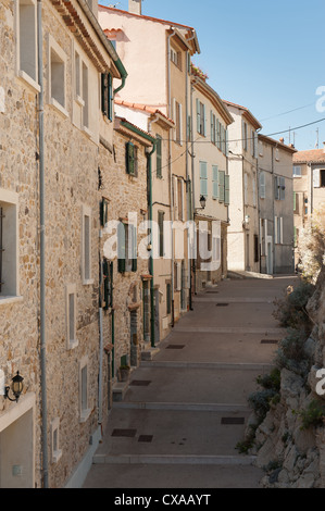 Traditional street and buildings in Antibes in the South of France - Stock Photo