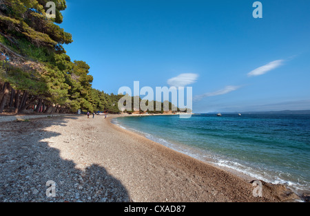 A beautiful sunny at the beach of Zlatni Rat (Golden Horn) near the town of Bol on the Adriatic island of Brač in - Stock Photo