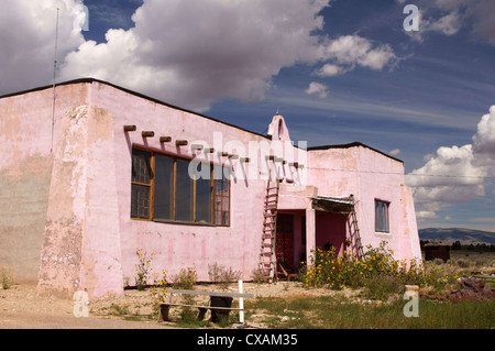 old pink schoolhouse tres piedras new mexico nm highway 64 historic historical place archival authentic - Stock Photo